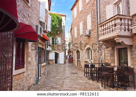view narrow street in old district of Budva, Montenegro - stock photo