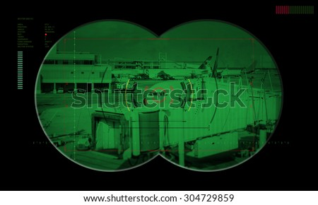 view of a airports in the crosshairs night vision device of terrorism  - stock photo