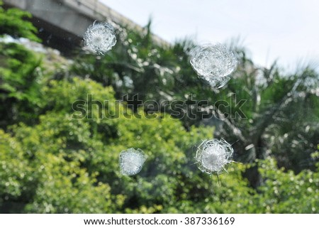 View of a Ballistic Glass Window Damaged by Bullets - stock photo