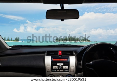 View of a beautiful beach from inside of a car. Real shot, not composite image. - stock photo