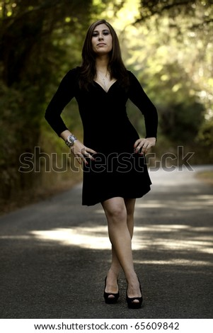 View of a beautiful woman on a forest road