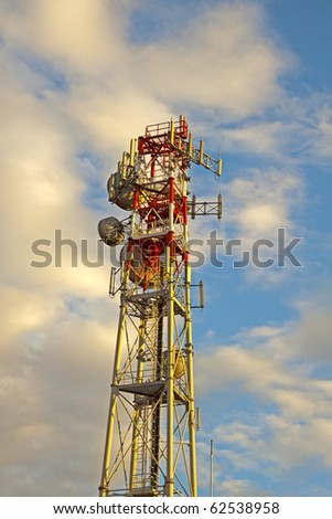 View of a big white and red antenna over cloudy sky - stock photo