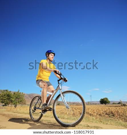 View of a biker riding a mountain bike outdoor - stock photo