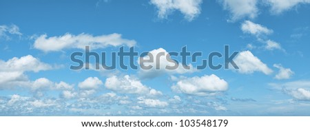 View of a blue cloudy sky. Panoramic composition in high resolution. - stock photo