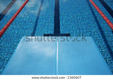View of a brand new swimming pool from the diving board - stock photo