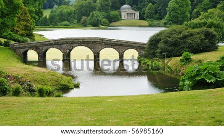 View of a Bridge and Lake in an English Landscape Garden - stock photo