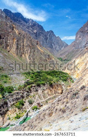 View of a bridge at the bottom of Colca Canyon in Peru - stock photo