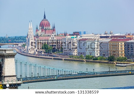 View of a building of the Hungarian parliament, Danube and chain Secheni Bridge - stock photo