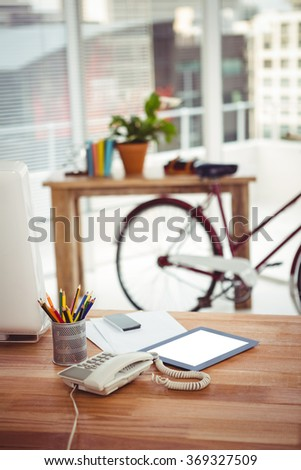 View of a business desk with a tablet in office - stock photo