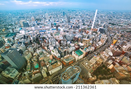 View of a bustling Tokyo from above - stock photo