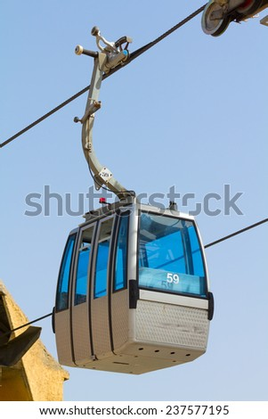 View of a cableway cabin leaving the station - stock photo