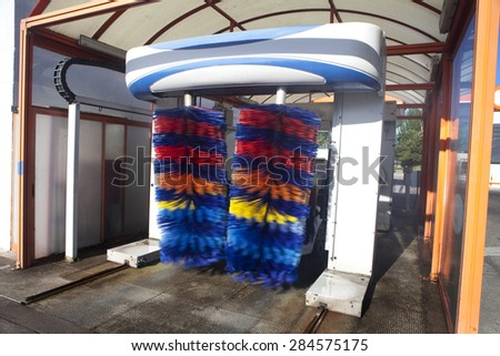 View of a car washing machine with multicolored rolls. Car Washing Machine - stock photo
