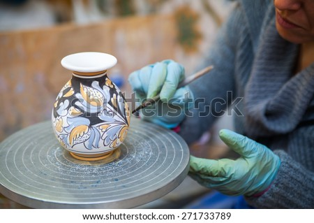 View of a ceramic vase from Caltagirone being decorated by a local artisan - stock photo