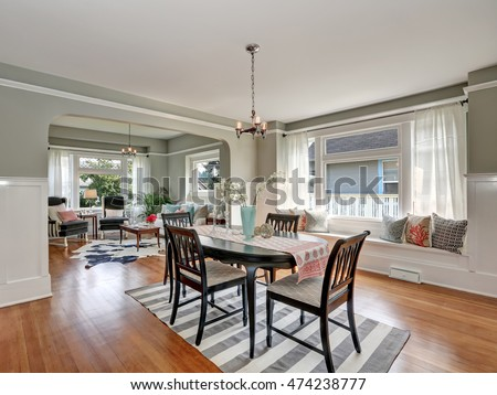 View Of A Classic Dining Room With Gray Walls And Medium Tone Hardwood Floors Dark