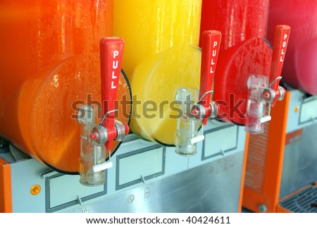 View of a colorful machine making frozen drinks - stock photo