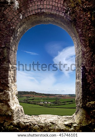 View of a cornish Landscape through an old arch window  of a tin mine. - stock photo