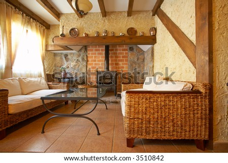 View of a cozy old living room with fireplace - stock photo