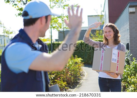 View of a Delivery man succeed during his delivery - stock photo