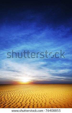 View of a desert at sunset time - stock photo