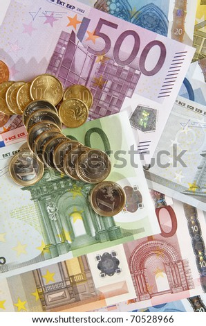 view of  a diverse group of  European banknotes and coins - stock photo