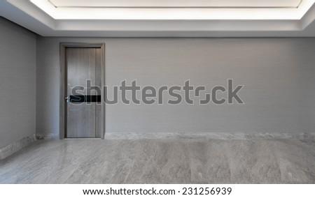 View of a door in an empty living room - stock photo