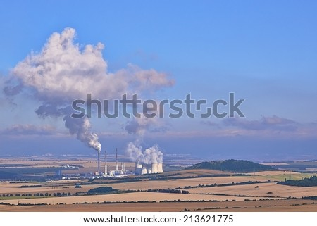 View of a factory in the landscape - stock photo