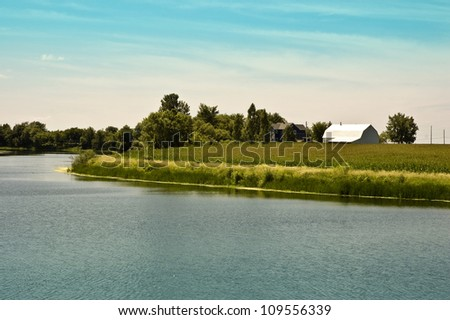 View of a farm near a river on the south shore of Montreal, Canada - stock photo