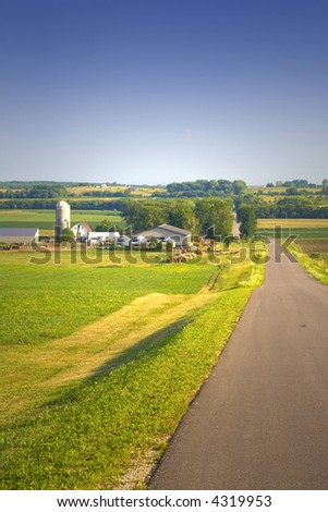 View of a farm under a blue sky - stock photo