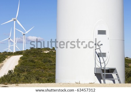 view of a field of windmills for electricity - stock photo