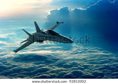 View of a fighter jet above the clouds - stock photo