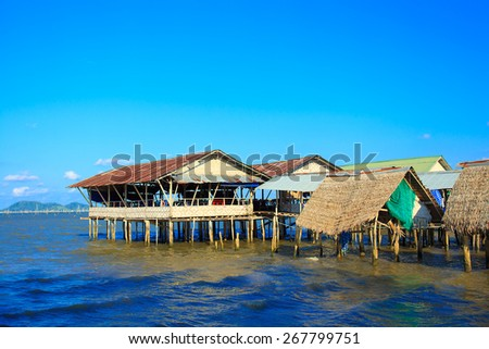 View of a fishing village. houses built on the  sea water