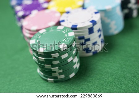 view of a gaming table with green mat - stock photo