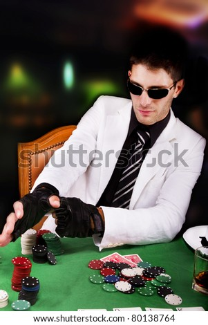 View of a gangster man playing some cards and poker. - stock photo