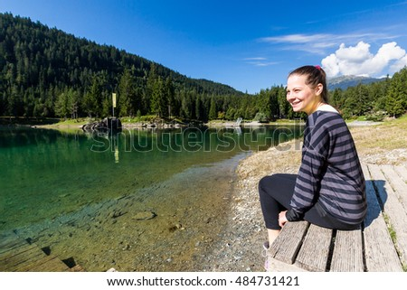 View of a girl at the beach of the Lake Cauma near Flims, Switzerland