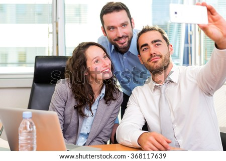 View of a Group of business associates working together at the office
