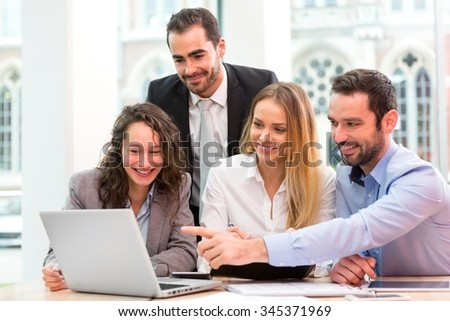 View of a Group of business people working together at the office