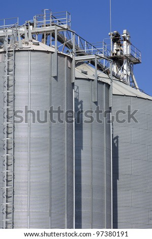 view of a group of metal silos for grain storage - stock photo