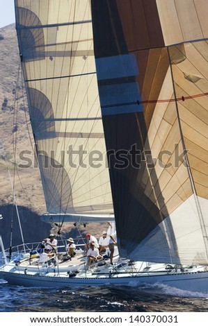 View of a group of sailors working on sailboat - stock photo