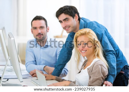 View of a Group of young active people working together - stock photo
