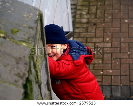 view of a happy child wearing a red coat - stock photo