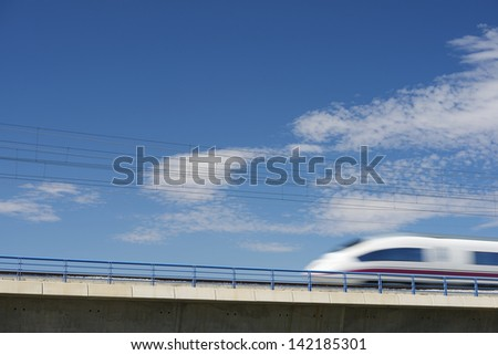 view of a high-speed train crossing a viaduct in El Burgo de Ebro, Saragossa, Aragon, Spain. AVE Madrid Barcelona - stock photo