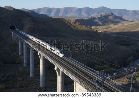 view of a high-speed train crossing a viaduct in Purroy, Saragossa, Aragon, Spain; AVE Madrid Barcelona - stock photo