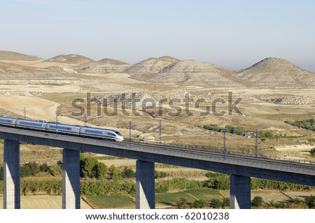 view of a high-speed train crossing a viaduct in Spain - stock photo