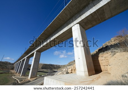 view of a high-speed viaduct in Alconchel de Ariza, Saragossa, Aragon, Spain. AVE Madrid Barcelona. - stock photo