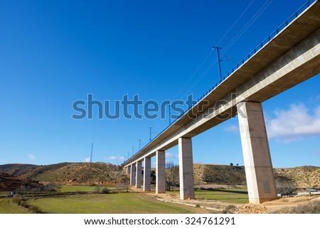 view of a high-speed viaduct in Alconchel de Ariza, Saragossa, Aragon, Spain. AVE Madrid Barcelona. - stock photo