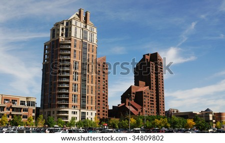 View of a highrise apartments under the blue sky, downtown of calgary, alberta, canada - stock photo