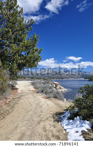 View of a hiking pathway which circles around Hemet Lake in Southern California. - stock photo