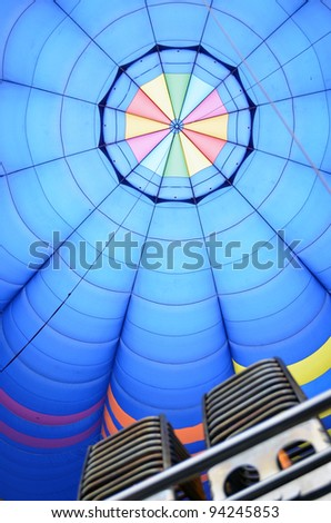 View of a hot air balloon from inside with burners - stock photo