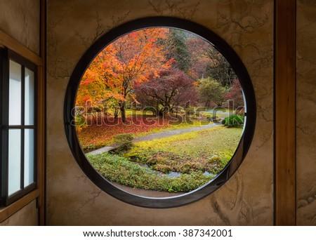 View of a Japanese Garden Through a Round Window - stock photo