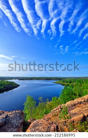 view of a lake in Northern Ontario from the hill - stock photo